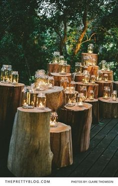Use natural elements, such as these tree stumps, to make a candlelit architectural feature or walkway for a forest, outdoor, fairy or fairytale wedding.