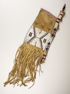 A UTE BEADED BUFFALO HIDE TOBACCO BAG. . c. 1870. ... American   Lot #77058   Heritage Auctions