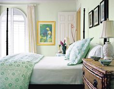 In this Florida bedroom by Jennifer Garrigues, sea green walls in PORTER PAINTS PARSLEY TINT 6998-1 (see next slide) are set off by BENJAMIN MOORE'S CLOUD WHITE 967 on the trim.   - HouseBeautiful.com