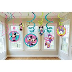 """Yoo-hoo! Did someone say """"party?"""" This pack of Minnie Mouse Swirls is ready to add some cuteness to any occasion. These decorations feature a metallic swirl in pink, light blue, or yellow, dandling a Minnie Mouse cutout at the bottom. Each pack contains 12 swirls.<br />"""