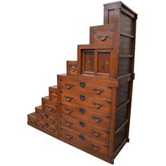 19Th. Century Japanese Staircase Tansu -1880 HEIGHT:6 ft. 9.1 in. (206 cm) WIDTH:6 ft. 3.6 in. (192 cm) DEPTH:26.38 in. (67 cm)
