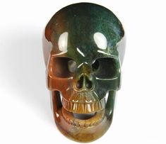 You are looking at an Indian agate skull. The skull is inches long from front to back. Skull Pictures, Indian Agate, Crystal Skull, Skeletons, Crystal Healing, Skulls, Singing, Carving, Rock