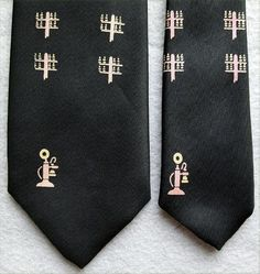 Narrow 1960s Men's black silk necktie with beige and pink candlestick telephones and telephone poles. Minty and clean, ready to wear. Offered at an