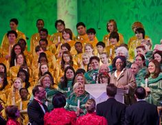 Candlelight Processional at Epcot is the telling of the Christmas story by a celebrity narrator with music sung by a mass choir and performed by a 50-piece