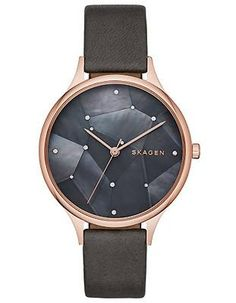 Star like accents shine against the genuine black mother of pearl dial accented by a rose gold-tone case. - Rose gold-tone stainless steel case - Black mother of pearl starry night dial - Genuine blac