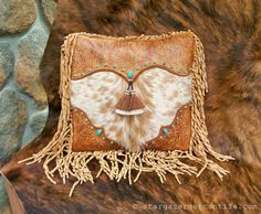 Rugged #Western styling make this #pillow a favorite! Tan leather with palomino hair-on cowhide #fur, sterling and turquoise conchos.