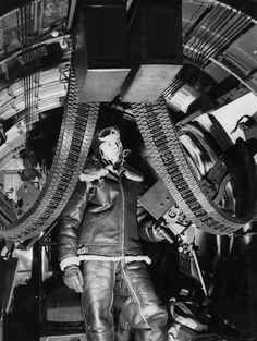 Staff Sergeant William Ewing of the 97th Bomb Group in position inside his B-17 Flying Fortress