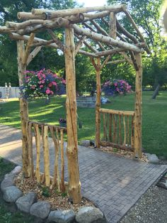 Log arbor rustic yard art.