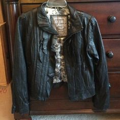 100% Leather Jacket Black leather jacket with Ruffles. Tags have been removed but this has never been worn Guess Jackets & Coats