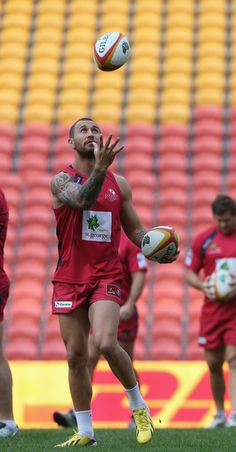 Quade Cooper, captain of Queensland Reds catches the ball during a Queensland Reds captain's run at Suncorp Stadium on June 7, 2013 in Brisbane, Australia.
