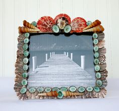 I think the seashells I have used would be ones you might find yourself during your beach vacation and this frame is a perfect way to keep those memories fresh.   $40.00