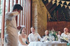 This wedding moment was captured during a wedding reception at Kingston Country Courtyard in Dorset. The bestman was making his speech and making jokes.     Reportage wedding photography by Dorset wedding photographer.