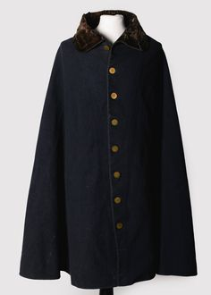 "Two Nerdy History Girls: The Duke of Wellington's Waterloo Cloak, 1815 - ""Unlike many of his officers, Wellington wasn't a clothes horse, and preferred simple, functional dress for battle instead of the flashy uniform that by rights he could have worn. Over his military career, he probably owned a number of other cloaks that looked just like this one: a single curved piece of of heavy blue wool, fulled to keep out rain and wind, with a velvet collar and facings and plain gilt buttons."""