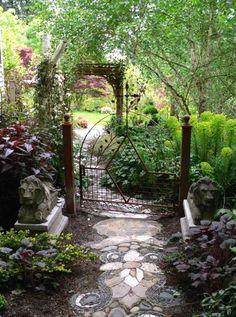 Lovely garden with a mosaic garden path leading to a beautiful gate #mosaic #tiles #home #exterior #garden #backyard #naturalstone