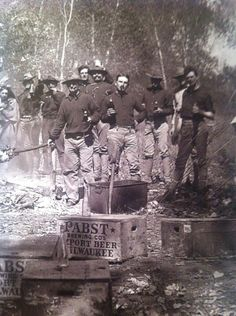 ...They were into anachronistic facial hair before it was anachronistic. This is a photograph of the Fort Riley Eighth Calvary Unit as they enjoy some blue ribbon beer and a roasted pig, taken near Junction City, Kansas (Rock Chalk Jayhawk!) in 1905...