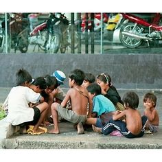 Street #children at the storefront of a shop of shiny brand new motorcycles. This scene still had been seen everywhere around downtown Saigon (Ho Chi Minh city. South #Vietnam)  in '02.  Photo and caption by @dep_hoi_dau ____ by ig_vietnam