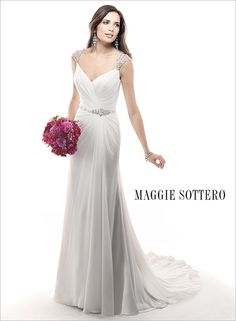 Incorporate sparkling beads into your wedding dress by dusting crystals on the cap-sleeves! Bryce, by Maggie Sottero, is a gorgeous sheath dress with delicate crystal cap-sleeves and a dazzling rhinestone belt.