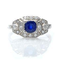 I like colored stones. .62 ct sapphire+diamonds... 1920s replica.