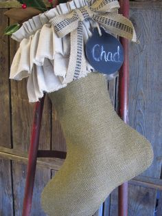 I'm not a fan of the ruffle part but burlap stockings could be cute!