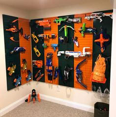 Toys for days! This sports team themed toy storage rack setup is easy to create with some mixing and matching of Wall Control's orange and green pegboards. Get creative with our colors to theme any wall or room. Thanks for the great photo Rebecca! Memories Box, Peg Board Walls, Arma Nerf, Nerf Gun Storage, Wall Storage, Storage Rack, Diy Toy Storage, Metal Pegboard, Toy Storage Solutions