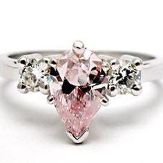 Pink diamond engagement ring.PEAR SHAPES ARE JUST A HANDS DOWN NO CONTEST KINDA THING FOR ME.