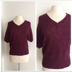 """GAP short sleeved sweater GAP deep burgundy sweater. Short sleeves (dolman style). Size M. 47% acrylic/ 36% wool/ 10% alpaca/ 7% nylon. Measures """" long. Very TTS. Slightly open knit- slightly see through. This is extremely soft and has great stretch! Perfect for Spring! Color in first two photos is true to color. VGUCNo trades. Poshmark onlyI am very open to fair offers! GAP Sweaters V-Necks"""