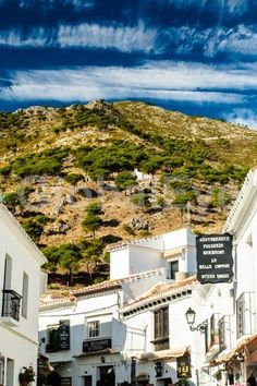 Mountain Over The Village. A view to the village of Mijas, Andalusia, Spain. The small building on the hill of the mountain is a church built on a spot where once was a hermit's cave.Stock Photo By Jukka   Heinovirta