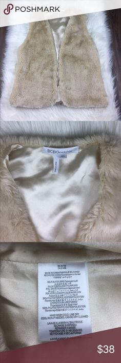 BCBGeneration Faux Fur Cream Vest Med / Large In great condition! Faux Fur cream vest jacket. One small stain in internal part of jacket, barely noticeable. Otherwise, perfect condition! BCBGeneration Jackets & Coats Vests
