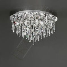 The Franklite Lighting Jazzy Large Round Bathroom Ceiling Light is in a Chrome finish with crystal glass drops graduating from the centre of the light. The Jazzy Crystal Ceiling Light is supplied by Luxury Lighting. Lighting Bugs, Lighting Store, Semi Flush Lighting, Semi Flush Ceiling Lights, Bathroom Ceiling Light, Bathroom Lighting, Master Closet Design, Crystal Ceiling Light, Crystal Decor