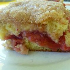 Strawberry Rhubarb Coffee Cake.  Note: added in a splash of juice to loosen the filling, bound up too soon. Maybe also cut the cornstarch a bit. Also, use a smaller, deeper pan next time for better coverage with the top cake layer (and a thicker filling layer!).