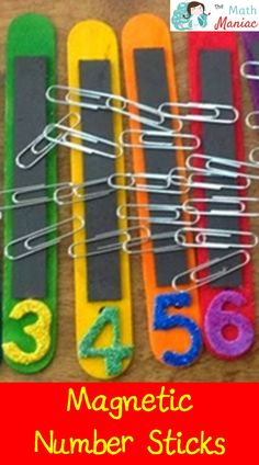 Magnetic Number Sticks:  Craft sticks with numerals & a magnet strip to hold the right amount of paper clips.  LOVE IT!