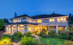 10407 SE 30th St, Bellevue, WA 98004 Enatai Lake & City VIEW w/ shared waterfront, one boat slip+dock. Builders own home, Designed by Vassos Demetriou. Real river rock, large great room. Chefs kitchen built for entertaining, large island, designer appliances, 5 burner gas stove and Subzero refrig. Beautiful, easy care Silestone counters. Windows everywhere, sound system. Huge master suite, fireplace, sitting area, generous master bath and custom etched windows and private deck.