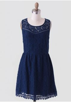 <p>Elegant and classy, this graceful navy dress is adorned with a floral lace overlay and scoop neckline. Accented with a scalloped crochet hem and a hidden back zipper, this dress pairs well with statement jewelry and a clutch for a stunning party look. Fully lined.</p> <p>Self: 85% Cotton, 15% Nylon<br /> Contrast 1: 100% Cotton<br /> Contrast 2: 100% Cotton<br /> Lining: 100% Polyester<br /> Imported<br /> 30