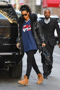 Rihanna keeps things classic in camel Timberlands and Fila.