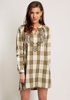 Green shift dress with plaid design and botanic embroidery. V-neckline with front and back pleats, long cuffed sleeves with button tab. Unlined, opaque.