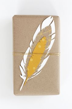 yellow feather gift tags with kraft paper