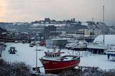 Winter Panorama from Dover Marina to Dover Castle, Kent, England, UK. Snow-covered yachts, sailing and fishing boats (including SY713 Spindrift C) on quayside above non-tidal Granville Dock with Wellington Dock beyond; both docks are Listed Buildings. Waterloo Crescent on right, Snargate Street on left, Burlington House in centre, and Victoria Park below Dover Castle on skyline. January 2013 from A20 Limekiln Street railway bridge. Travel and Tourism. See…