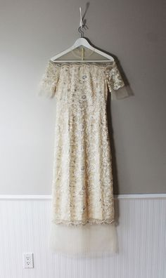 This stunning prom dress is constructed of a high-quality woven fabric, adorned with an ornate lace . This dress features a shoulder-less neckline and a