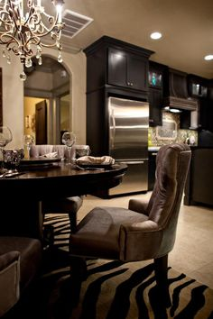 dining rooms - Bella Vici Interiors Black Kitchen Undercounter Lighting Slate Backsplash Chrome Crystal Tufted Zebra Rug