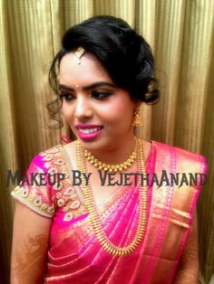 Traditional Southern Indian bride wearing bridal silk saree and jewellery. Reception look. Makeup and hairstyle by Vejetha for Swank Studio. #BridalSareeBlouse #SariBlouseDesign Silk kanchipuram sari. Braid with fresh flowers. Tamil bride. Telugu bride. Kannada bride. Hindu bride. Malayalee bride  Find us at https://www.facebook.com/SwankStudioBangalore