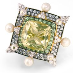 De Boulle Collection Decadence Ring Art Deco inspired ring featuring a lush Citrine, framed by a border of Tsavorite Garnets and another row of green Sapphires. Diamonds and Pearls adorn the sides of the frame as well as the corners.