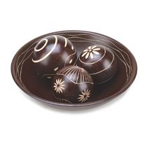 The rich, chocolate brown color of this decorative ball and basin set will fit right into any décor. Each ball's carved design is different and they are set in matching bowl with delicate interior carving to create a fascinating décor accent.