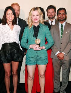 Congrats to the cast of Parks and Recreation for their Peabody Award.  Love this pic for 2 reasons... first, both of the females are rocking dressed-up short outfits.  And second, check out Nick (Ron Swanson) Offerman's blond hair!
