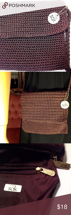 "The Sak, Cross Body Bag, Brown Crochet Purse Hand Made Crochet Bag Gold Tone Hardware Signature Logo Right Side of Purse Inside Zipper Pocket Single Strap 44"" Length Width 7"" Height 6"" Orders ship within 1 Business Day excluding weekends. Add multiple items to a bundle to get 15% off, plus you'll save on shipping. Thanks For Shopping with Dress To Impress Thrift & Boutique.  Have A Great Day The Sak Bags Shoulder Bags"
