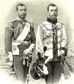 Prince George (later King George V) of England and Tsar Nicholas II of Russia...1890...first cousins, but look like twins.