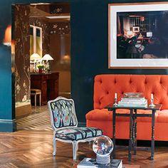 Miles Redd - living rooms - peacock, blue, walls, teal, walls, orange, tufted, settee, blue, orange, living room, Peacock blue teal walls paint