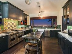 Megan Fox and Brian Austin Green's Los Angeles Home for Sale: Kitchen http://www.frontdoor.com/photos/out-with-the-old-in-with-the-new-compare-megan-fox-and-brian-austin-greens-homes?soc=pinterest