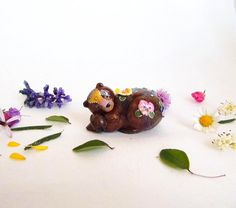 Bear figurine. Sweet dreaming bear with pansies. One of a kind.