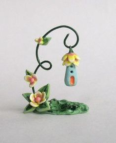 Polymer clay stand with house pendant/ornament                                                                                                                                                                                 More