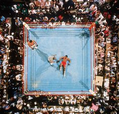 "Muhammad Ali defeats George Foreman at the famous 1974 ""Rumble in the Jungle"" in Kinshasa, Zaire. (Neil Leifer/SI)"